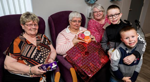 Lewis and Reece McCartney give gifts to Mabel Stevenson, Selina Irvine and Linda Mulholland