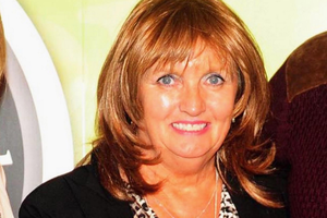 A US stepdaughter of Julia Holmes says she told her that her Irish family died in a house fire