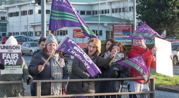 Health service workers on strike at Altnagelvin Area Hospital yesterday