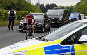 Police stop traffic at a checkpoint in Belfast yesterday