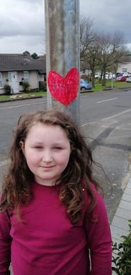 Brooke Hull has been putting hearts up on the path she walks so her friends can see them