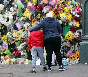 The mass of floral tributes outside Noah's school, St Malachy's College