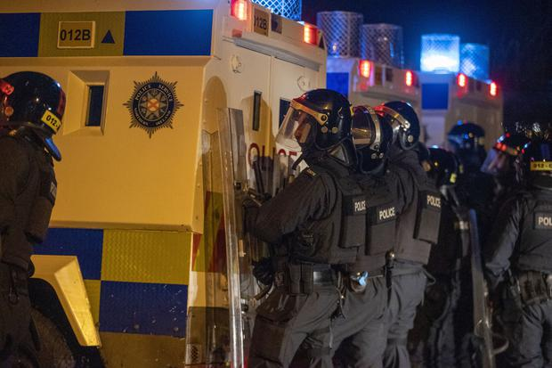 PSNI Tactical Support Group officers were called to the loyalist Nelson Drive Estate on Monday night (Liam McBurney/PA)