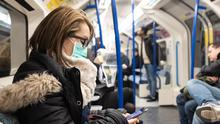 A woman wearing a face mask on the London Underground (Ian Hinchcliffe/PA)