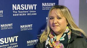 Jane McConville, a teacher at Elmgrove Primary School in east Belfast, takes part in the National Association of Schoolmasters Union of Women Teachers (NASUWT) rally over pay, workloads and job security, in the Europa Hotel, Belfast
