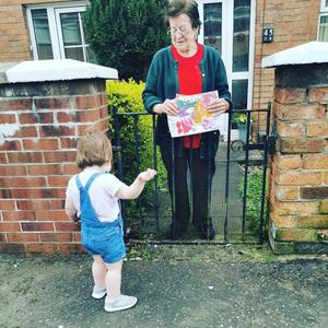 Little Lily delivering art to a neighbour