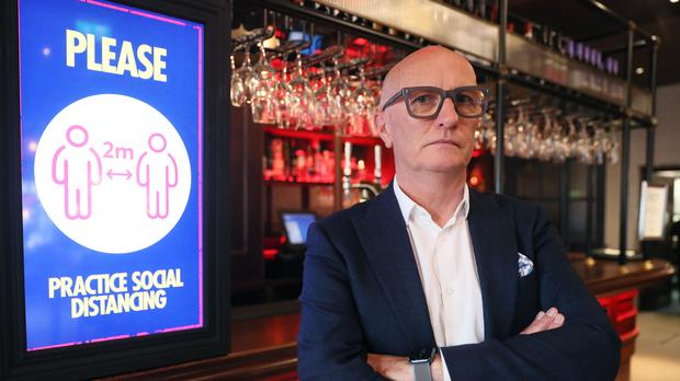 """Colin Neill, chief executive of Hospitality Ulster, at the Northern Whig Bar and Restaurant in Belfast. He says  the Executive's own evidence showed the previous curfew had a """"marginal impact"""" on the spread of Covid-19. (Brian Lawless/PA)"""