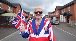 Julie Stockman takes part in one of many socially distanced street parties around Belfast's Shankill Road to mark the 75th anniversary of VE Day (PA)