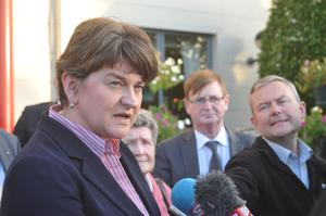 DUP leader Arlene Foster and Willie Frazer (second right) after a meeting with Simon Coveney at Armagh City Hotel yesterday