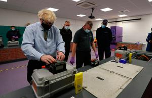 Hands on: Prime Minister Boris Johnson during a visit to the Openreach L&D Training Centre in Bolton yesterday