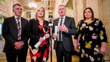 Finance Minister Conor Murphy (second from right) speaks to the media alongside Sinn Fein colleagues, Deputy First Minister Michelle O'Neill (second from left), Junior Minister Declan Kearney and Communities Minister Deirdre Hargey at the Great Hall in Stormont