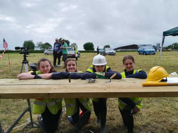 Kayla McDermott, Amy Spain, Hannah Walker and Grace McNee from Foyle College posing with a model P38 fighter aircraft (Dylan and Grace McNee/PA)