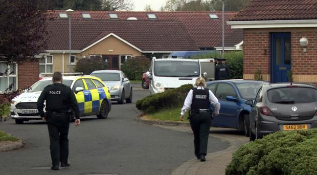 Police at the scene where Timothy Graham was stabbed in Bangor