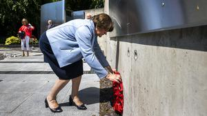 DUP leader Arlene Foster lays a wreath at the Royal Ulster Constabulary George Cross Foundation Memorial Garden (Liam McBurney/PA)