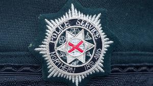 A stock picture of a Police Service of Northern Ireland logo badge in Derry City in Northern Ireland (PA)
