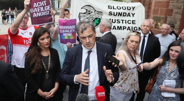 Julian Smith speaks to the media as he arrives at the Guildhall in Londonderry (Brian Lawless/PA)
