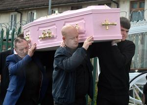 Shauneen's father Paul and brother Ryan carry her coffin into the church at New Barnsley yesterday