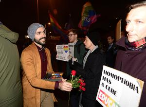 Matthew Grech offers flowers and sweets to protesters outside Townsend Presbyterian Church in Belfast, where the film was being shown last night