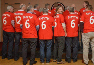 Davy Smyth surrounded by former colleagues at a party in his honour