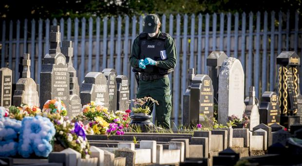 Police at Milltown Cemetery