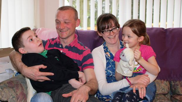 Dad Graham and mum Joanne with son Andrew (8) and daughter Faith (6). The family are raising funds for Northern Ireland Children's Hospice who care for Andrew at home and at the hospice