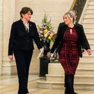 Northern Ireland First Minister Arlene Foster (left) and Deputy First Minister Michelle O???Neill as they make their way to a press conference, to announce that nurses in Northern Ireland will receive a pay rise in a
