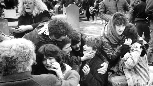Mourners panicking at Milltown Cemetery, Belfast, after a gun and hand grenade attack was launched by loyalist Michael Stone