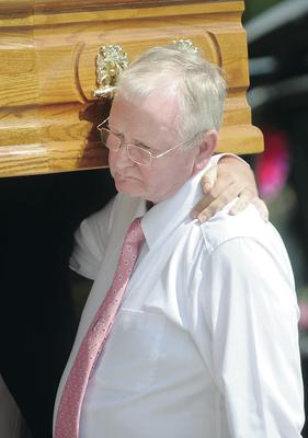 Noleen Adair's father carries her coffin at the funeral of the Pretty 'n' Pink cancer charity founder