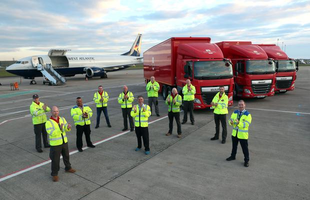 Key workers from Royal Mail at Belfast International Airport join in the clapping