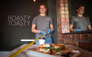 Annette Fusco measures the tables at Roasty Toasty cafe in Belfast