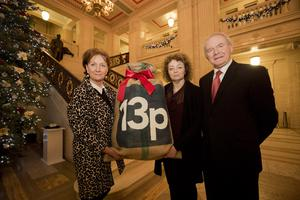 Arts Council chief executive Roisin McDonough presents Minister for Culture Caral Ni Chuilin and Deputy First Minister Martin McGuinness with a petition signed by more than 11,500 people backing the 13p for the arts campaign