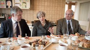 Theresa May having lunch with farmers in Bangor, Northern Ireland (Stefan Rousseau/PA)