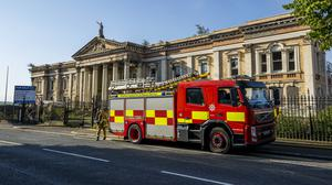 Firefighters tackling a large fire at Crumlin Road Courthouse in Belfast (Liam McBurney/PA)