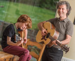 Joe O'Sullivan strums with his son Oisin