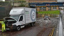 Vehicles break down after flooding on the Laganbank Road yesterday
