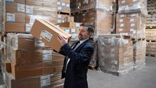 Northern Ireland health minister Robin Swann during a visit to a PPE distribution centre in Belfast (Michael Cooper/PA)