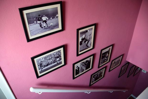 Personal family and professional sports photographs on display at the George Best House