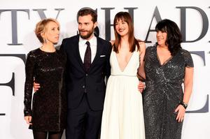 On the red carpet at the UK premiere of Fifty Shades in Leicester Square last night are Jamie Dornan and Dakota Johnson with director Sam Taylor-Johnson (left) and author EL James