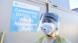 An Emergency Department Nurse during a demonstration of the Coronavirus pod and COVID-19 virus testing. Michael Cooper/PA Wire