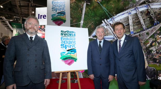 At the launch of a new destination brand for Northern Ireland at World Travel Market in London are (from left) artist Colin Davidson, Tourism NI's chief executive John McGrillen and Shane Clarke, Tourism Ireland's director of corporate services and policy