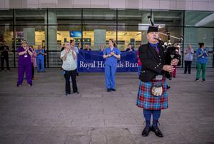 A piper plays for staff at the Royal Victoria Hospital in Belfast