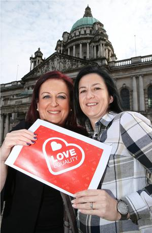 Engaged couple Cara McCann and Amanda McGurk at Belfast City Hall ahead of their lobbying trip to Westminster this week
