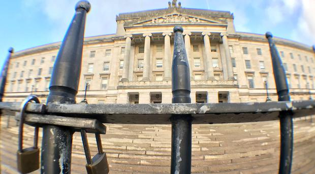Padlocked gates of the parliament buildings Stormont in Belfast (Niall Carson/PA)