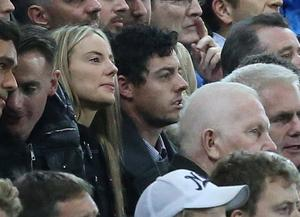 Loved-up: Rory McIlroy with Erica Stoll at Windsor Park