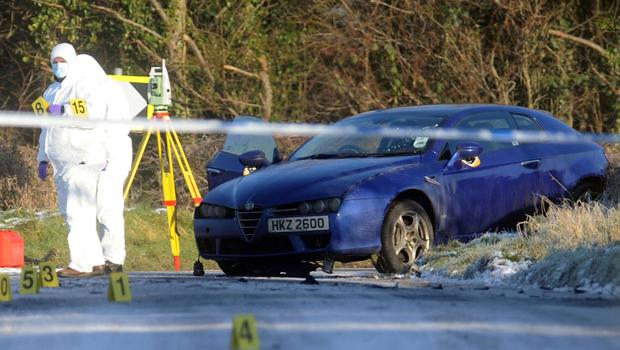 Forensics officers at the scene after the car bomb attack on Peadar Heffron near Randalstown in January