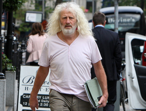 Peter Robinson has threatened legal action over the contents of a tweet by the Irish independent TD Mick Wallace (pictured)
