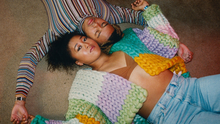 Rainbow knit: Australian Open tennis champion Naomi Osaka's cover shoot for the March edition of GQ magazine, wearing a chunky knitted cardigan by NI designer Hope Macaulay