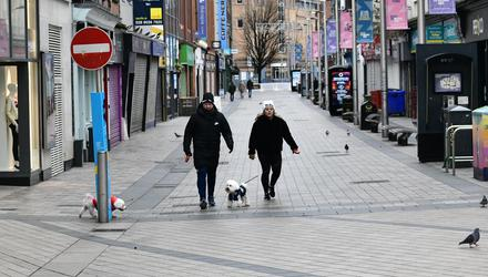 Restrictions: A near-deserted Belfast city centre on Boxing Day 2020 on the first day of a six-week lockdown in Northern Ireland. Credit: Pacemaker