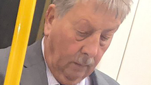 Sammy Wilson on the Underground with no mask on