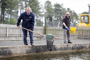 Edwin Poots during his visit to Movanagher Fish Farm in Ballymoney